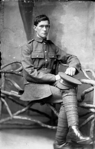 Soldier, Welsh Regiment, seated
