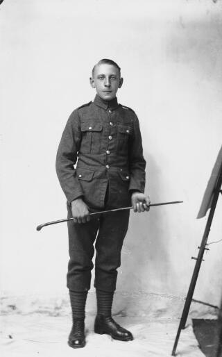 Soldier next to blackboard