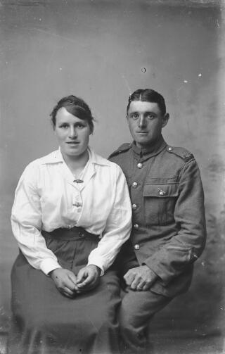 A private in the Welsh Regiment with his wife