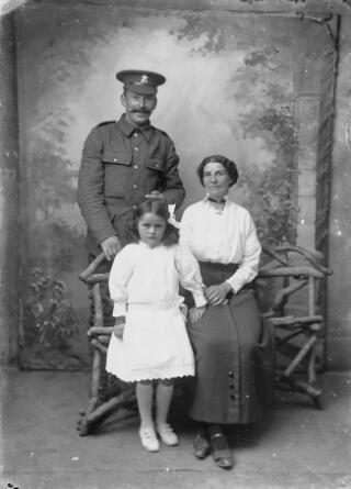 Welsh Regiment private with his wife and daughter