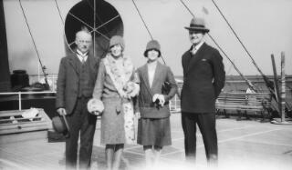 L-R A bespectacled middle aged gent, lady in two piece suit, young lady in fur trimmed coat, gent in dark suit and hat photographed on the deck of a ship.Very similar to PZ7890/4.